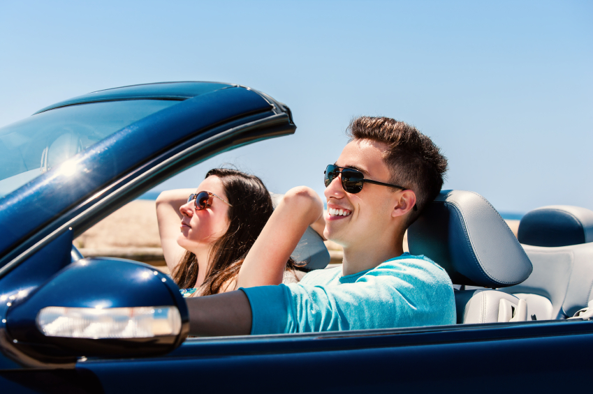 Attractive Young People Cruising in Convertible